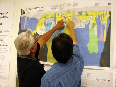 Roy Takemoto and Takashi Domingo Check out the Major Landowner Map